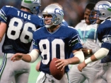 October 6, 1986 photo. ORIGINAL CAPTION: Steve Largent has the ball he caught in an NFL-record 128th consecutive game and a big smile as he reaches out to shake one of many hands thrust toward him. Previous UID: 0392514323